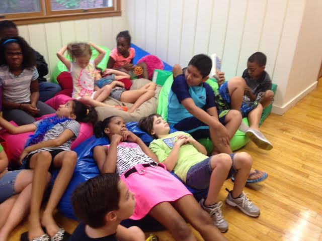 summer camp kids on bean bags